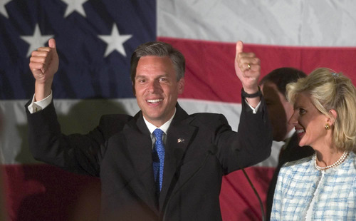 File Photo  |  The Salt Lake Tribune Jon Huntsman would get walloped in a Utah Republican primary head-to-head with Mitt Romney, according to a new poll. Huntsman is shown here celebrating his first of two gubernatorial election victories in Utah, in 2004.