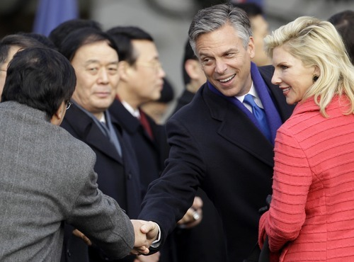 U.S. Ambassador to China Jon Huntsman and his wife Mary Kaye, right, greet members of the Chinese delegation before President Barack Obama welcomed China's President Hu Jintao, Wednesday, Jan. 19, 2011, during a state arrival on the South Lawn of the White House in Washington. (AP Photo/Charles Dharapak)