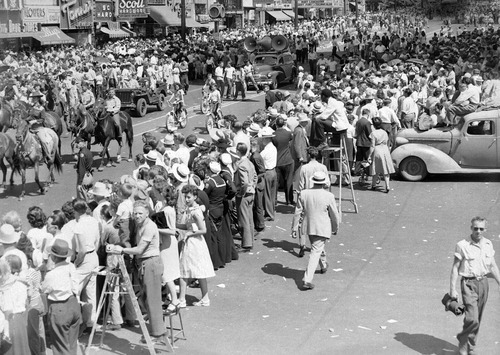 Tribune file photo  Huge crowds gather to watch the Days of '47 Parade on July 24, 1947. Note the people standing on ladders and stools to get a better view.
