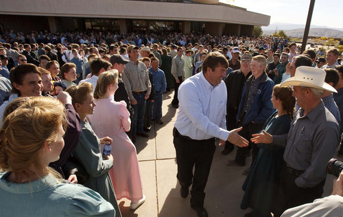 Trent Nelson  |  The Salt Lake Tribune FLDS member Willie Jessop shakes hands and shares smiles with other FLDS followers in front of the 5th district courthouse Friday, November 14, 2008 after the Utah Attorney General's Office stepped in to seek a resolution to litigation involving the sect's UEP  land trust. The hearing, which sparked an unprecedented public showing of FLDS members, was continued in order to allow time for  both sides to discuss a