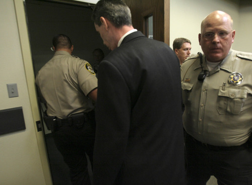 Jud Burkett  |  Associated Press file photo Warren Jeffs leaves the courtroom after having verdicts against him were handed down Tuesday, Sept. 25, 2007, in St. George, Utah. The leader of the polygamous Mormon splinter group was convicted of being an accomplice to rape for forcing a 14-year-old girl to marry her 19-year-old cousin.