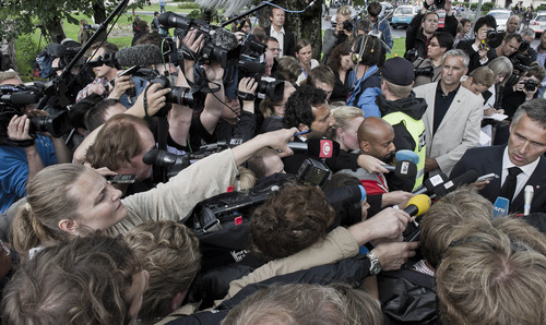 A man is taken away by police, who told members of the media as he was loaded into a police car, that he had been carrying a knife, shortly after Norway's Prime Minister Jens Stoltenberg arrived at a hotel in Sundvolden, Norway, to meet survivors from the shooting at an island youth retreat, Saturday, July 23, 2011.  Norway's prime minister and royal family visited grieving relatives of the scores of youth gunned down in a horrific killing spree on an idyllic island retreat. A man who said he was carrying a knife was detained by police officers outside the hotel, as the shell-shocked Nordic nation was gripped by reports that Norwegian gunman may not have acted alone.  (AP Photo/Matt Dunham)