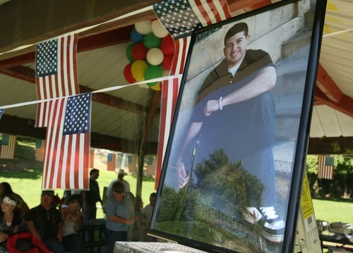 Leah Hogsten     The Salt Lake Tribune A photo of Raphael Arruda greeted visitors to the South Ogden Park. Family, friends and loved ones gathered Saturday, July 23 2011 in South Ogden to celebrate the late U.S. Army Cpl. Raphael Arruda's 22nd birthday in South Ogden.  Arruda, a native of Brazil, died of blunt force trauma when the mine-protected vehicle he was riding in was struck by a roadside bomb in the Bar Kunar District of Kunar province on July 16, 2011.  Arruda was a member of the U.S. Army Reserves 744th Engineering Company, 2nd Platoon