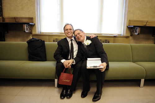 Joseph Oroza, left, and Jim Consolantis, both of New York, wait for their turn to be married at the Manhattan City Clerk's office, Sunday, July 24, 2011, in New York. Hundreds of gay couples were expected to marry in New York and across the Empire State on the first day of same-sex marriage ceremonies. (AP Photo/ Anthony Behar, Pool)