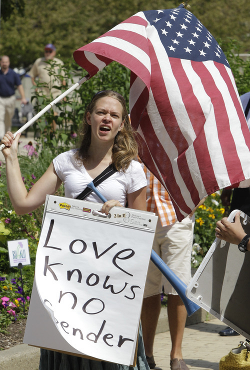 Jessica Lang chants in support of gay marriage at a rally at City Hall in Buffalo, N.Y., Sunday, July 24, 2011. (AP Photo/David Duprey)