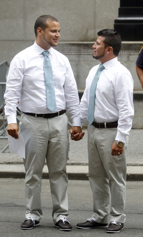 Marcos Chaljub, left, and Freddy Zambrano, of Astoria in the Queens borough of New York, react after getting married at the Manhattan City Clerk's office, Sunday, July 24, 2011 in New York. (AP Photo/Jason DeCrow)