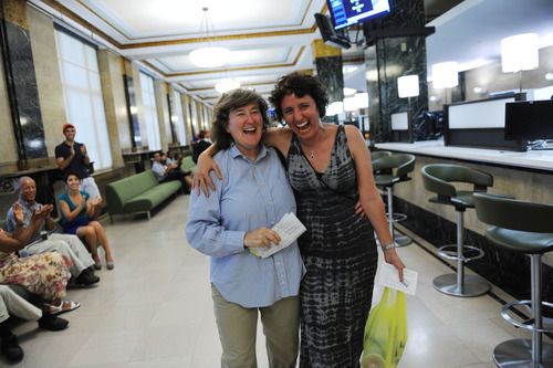 Same-sex couple Erika Karp, left, and Sari Kessler arrive at the City Clerk's Office for their wedding ceremony, Sunday, July 24, 2011, in New York. Sunday is the first day that same-sex couples can legally marry in New York state. (AP Photo/David Handschuh, Pool)