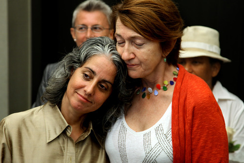 Carol Anastasio, left and Mimi Brown, of New York, embrace during their marriage ceremony at the City Clerk's office in New York, Sunday, July 24, 2011. Hundreds of gay couples were expected to marry in New York and across the Empire State on the first day of same-sex marriage ceremonies. (AP Photo/Craig Ruttle, Pool)