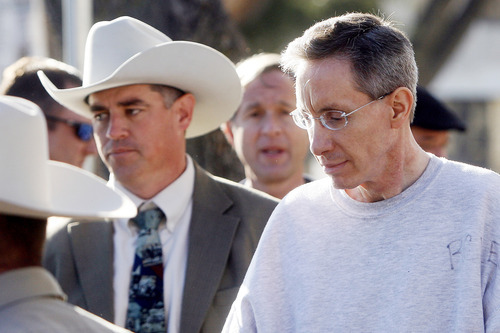 Facing charges of sexual assault, Warren Jeffs is walked to a waiting car for transport back to Big Lake Wednesday morning after a brief pretrial hearing at the Tom Green County Courthouse in San Angelo. Patrick Dove/Standard-Times. 12.08.10