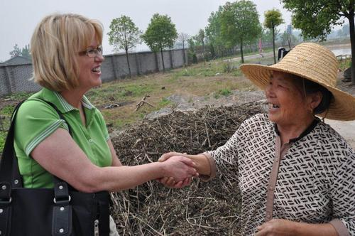 Shauna Mendini, Dean of SUU's College of Performing and Visual Arts, (left) greets a woman in Wuhan, China. (Courtesy photo by Fang Xiao Su of Hubei Opera and Dance Drama Theatre, Wuhan, China.)