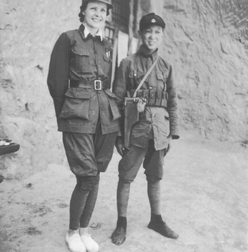 Helen Snow poses beside her bodyguard Demmy-erh (Dai Ming-er) from Sichuan. Photograph courtesy of the Helen Foster Snow Papers at Brigham Young University, Perry Special Collections, Harold B. Lee Library.