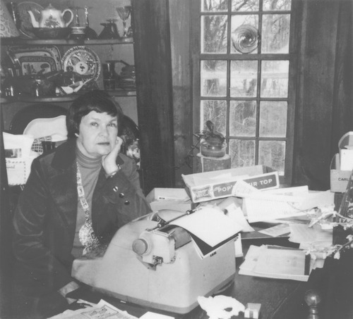 At home in Madison, Connecticut, Helen looks up from her old manual typewriter and stacks of work in progress. Photograph courtesy of the Helen Foster Snow Papers at Brigham Young University, Perry Special Collections, Harold B. Lee Library.