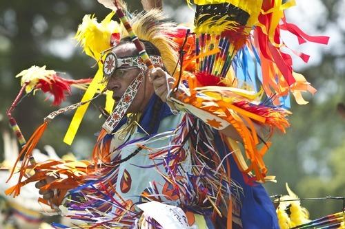 Chris Detrick   The Salt Lake Tribune  Show Taylor, Salt Lake City, dances the fancy feather dance during the Native American Cultural Celebration at Liberty Park Monday July 25, 2011.