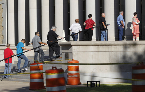 Prospective jurors arrive at the Tom Green County Courthouse, Monday, July 25, 2011, in San Angelo, Texas, where jury selection is set to begin for the trial of Polygamist leader Warren Jeffs . Jeffs faces two counts of sexual assault of a child.  (AP Photo/Eric Gay)