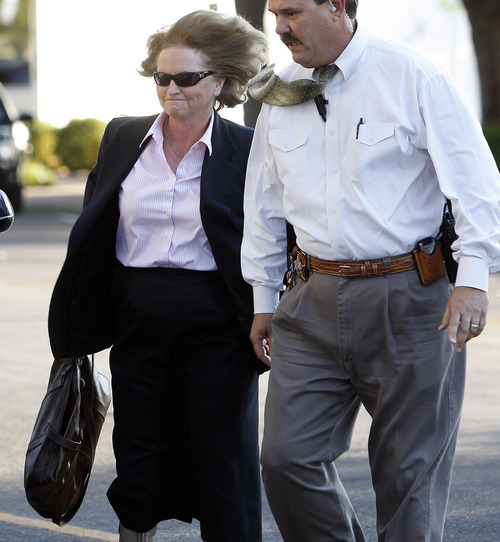 Judge Barbara Walthers, left, arrives at the Tom Green County Courthouse, Monday, July 25, 2011, in San Angelo, Texas, where jury selection is set to begin for the trial of Polygamist leader Warren Jeffs . Jeffs faces two counts of sexual assault of a child.  (AP Photo/Eric Gay)
