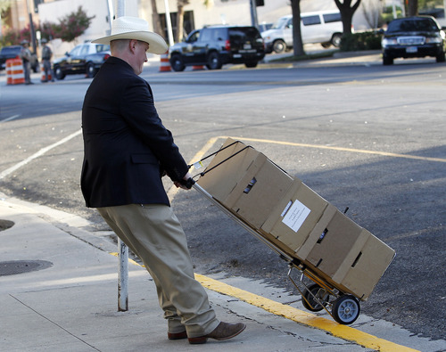 Documents related to the trial of Polygamist leader Warren Jeffs arrive at the Tom Green County Courthouse, Monday, July 25, 2011, in San Angelo, Texas, where jury selection is scheduled to begin. Jeffs faces two counts of sexual assault of a child.  (AP Photo/Eric Gay)