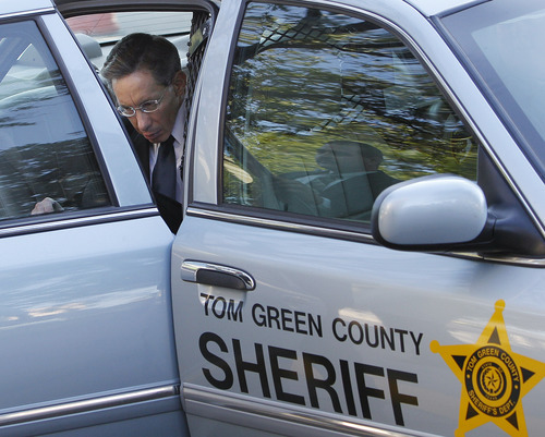 Polygamist leader Warren Jeffs arrives at the Tom Green County Courthouse, Monday, July 25, 2011, in San Angelo, Texas, where jury selection is scheduled to begin. Jeffs faces two counts of sexual assault of a child.  (AP Photo/Eric Gay)