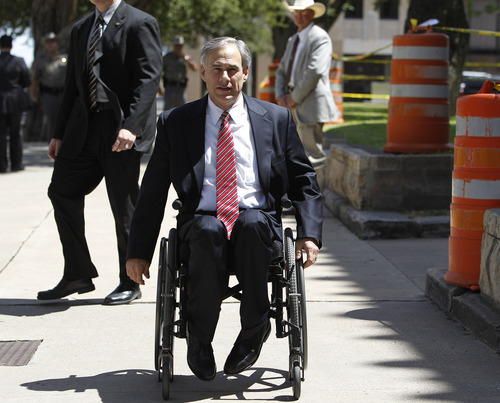 Texas Attorney General Greg Abbott  leaves the Tom Green County Courthouse, July 25, 2011, in San Angelo, Texas, where jury selection began Monday for the trial of Polygamist leader Warren Jeffs . Jeffs faces two counts of sexual assault of a child.  (AP Photo/Eric Gay)