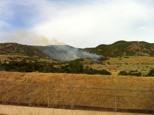 A wildfire burns Wednesday in Farmington Canyon.