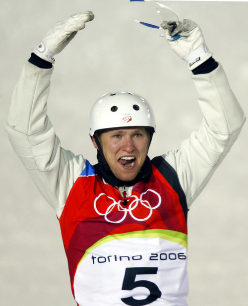 Jeret 'Speedy' Peterson of the United States reacts after performing the first jump at Men's Aerials final at the Turin 2006 Winter Olympic Games at Sauze d'Oulx, Italy, Thursday, Feb. 23, 2006. (AP Photo/Luca Bruno)