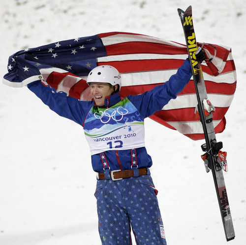 FILE- In this Feb. 25, 2010 file photo, Jeret Peterson of the United States, celebrates his Olympic silver medal in the men's freestyle aerials final at the Vancouver 2010 Olympics in Vancouver, British Columbia. Utah police say Peterson has killed himself in an isolated canyon.  The Unified Police of Greater Salt Lake said Peterson called 911 before shooting and killing himself on Monday evening, July 25, 2011. (AP Photo/Marcio Jose Sanchez, File)