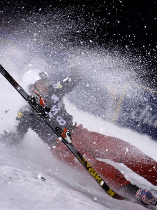 A ski flies off as Jeret Peterson crashes Friday. Trent Nelson, The Salt Lake Tribune