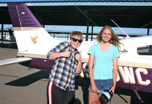Katie Whiting (left) 16, strikes an excited pose before she takes flight with her fellow camper, Kaitlin Owens, 17 both from Park City. Westminster College Aviation campers get two flights in one of the college's aircraft fleet. Photo: Emily Johnson
