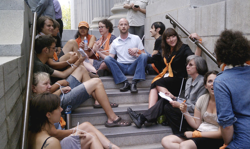Jason Bergreen  |  The Salt Lake Tribune  Derek Snarr, center, and others participate in a protest on the steps of the Frank E. Moss Federal Courthouse following the sentencing of Tim DeChristopher in Salt Lake City on Tuesday, July 26, 2011.