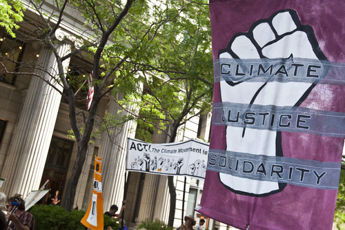 Chris Detrick | The Salt Lake Tribune  Supporters of Tim DeChristopher rally across from the Federal Courthouse in Salt Lake City on Tuesday, July 26, 2011. DeChristopher, the 29-year-old climate activist turned environmental folk hero, was sentenced Tuesday to spend two years in prison for disrupting a federal oil and gas lease auction, and fined $10,000.