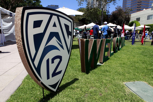 Guests are welcomed to the Pac-12 football media day outside the commissary at Fox Studios in Los Angeles, on Tuesday, July 26, 2011. (AP Photo/Reed Saxon)