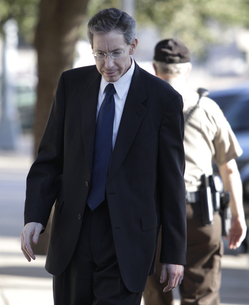 Tony Gutierrez  |  The Associated Press  Polygamous sect leader Warren Jeffs, center, arrives at the Tom Green County Courthouse in San Angelo, Texas, on Thursday. Jeffs' much-anticipated Texas trial begins in earnest Thursday, with prosecutors claiming he sexually assaulted girls he manipulated into