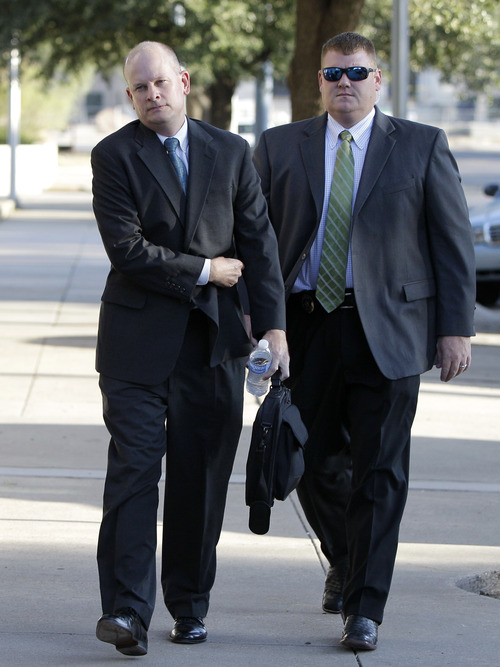 Tony Gutierrez  |  The Associated Press  Lead prosecutor for the state Eric Nichols, left, in the trial of polygamist leader Warren Jeffs, arrives with an escort at the Tom Green County Courthouse in San Angelo, Texas, on Thursday.