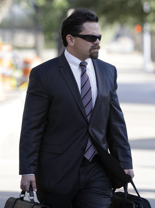 Tony Gutierrez  |  The Associated Press  Deric Walpole, the former lead defense attorney for polygamist leader Warren Jeffs arrives at  the Tom Green County Courthouse  in San Angelo, Texas, on Thursday. Jeffs will represent himself at his sexual assault trial after dismissing his latest legal team, the seventh one, Thursday, just before his trial was to begin.
