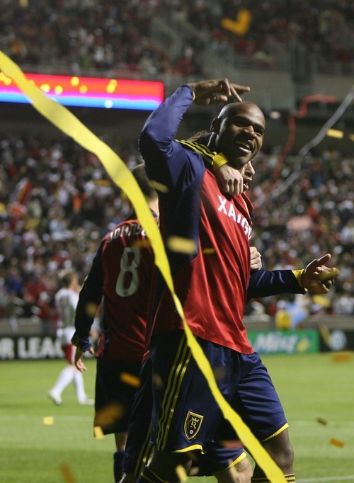 Real Salt Lake's Jamison Olave celebrates scoring the first goal for RSL during  the inaugural game at Rio Tinto stadium.  Real Salt Lake tied the New York Red Bulls 1-1 on Thursday. Scott Sommerdorf / The Salt Lake Tribune
