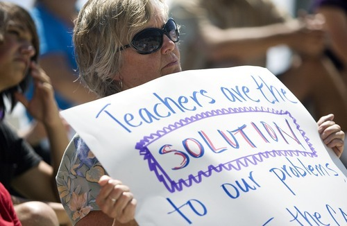 Djamila Grossman  |  The Salt Lake Tribune  Ann Florence, an English teacher at Wasatch Jr. High School, listens to a speaker during a protest organized by Save Our Schools, at the Salt Lake City Public Library, Utah, on Friday, July 29, 2011.