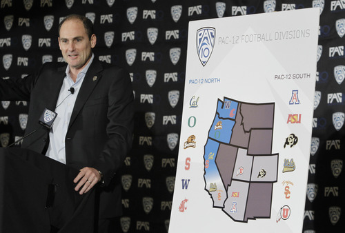 FILE - In this Oct. 21, 2011 file photo, Pac-10 commissioner Larry Scott announces the splitting of NCAA college football divisions during a news conference in San Francisco. Since taking over a conference that was stuck in neutral in July 2009, Scott has orchestrated the largest TV deal in college history, restructured the league and its tournaments, saved sports from being slashed, pulled rival programs together to share revenue and put the nation on notice: The Pac-12 is not just a BCS conference, it's reshaping college athletics. (AP Photo/Paul Sakuma, file)