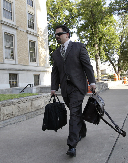 Tony Gutierrez  |  The Associated Press  Deric Walpole, the former lead defense attorney for polygamist leader Warren Jeffs, arrives at  the Tom Green County Courthouse for the second day of Jeffs' sexual assault trial on Friday in San Angelo, Texas. District Judge Barbara Walther has allowed Jeffs to defend himself. Jeffs is charged with two counts of sexual assault of a child at a compound south of the oil and gas town of San Angelo.