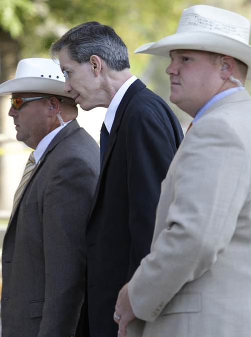Tony Gutierrez     The Associated Press  Law enforcement officials escort polygamous sect leader Warren Jeffs into the Tom Green County Courthouse in San Angelo, Texas, for the second day of his sexual assault trial Friday. Jeffs is charged with two counts of sexual assault of a child at a compound south of the oil and gas town of San Angelo.