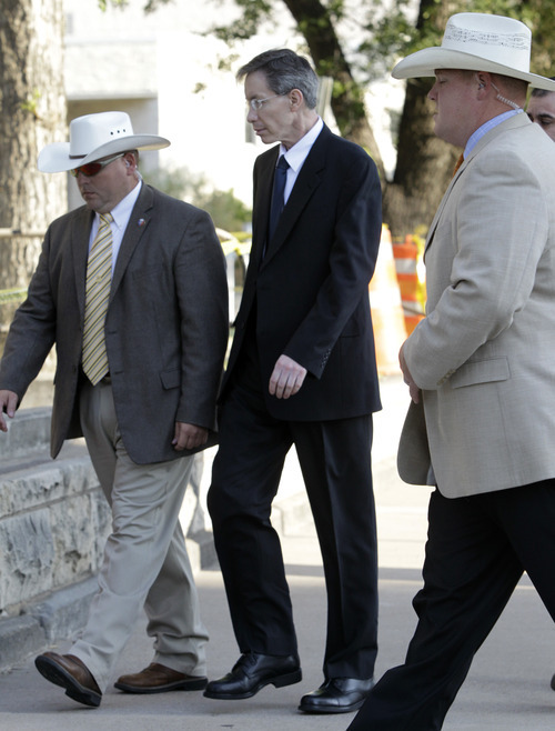 Tony Gutierrez     The Associated Press  Law enforcement officials escort polygamous sect leader Warren Jeffs into the Tom Green County Courthouse in San Angelo, Texas, for the second day of his sexual assault trial on Friday. Jeffs is charged with two counts of sexual assault of a child at a compound south of the oil and gas town of San Angelo.