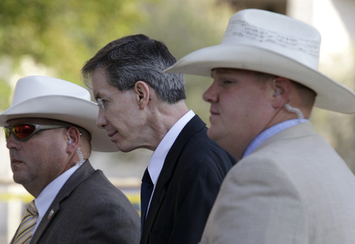 Tony Gutierrez  |  The Associated Press  Law enforcement officials escort polygamous sect leader Warren Jeffs into the Tom Green County Courthouse in San Angelo, Texas, for the second day of his sexual assault trial on Friday. Jeffs is charged with two counts of sexual assault of a child at a compound south of the oil and gas town of San Angelo.