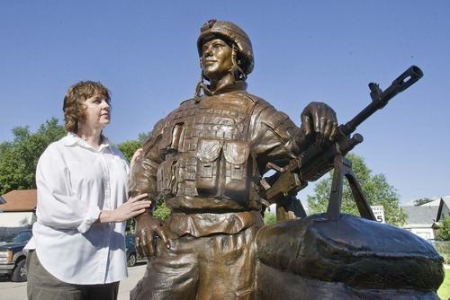 Paul Fraughton  |  The Salt Lake Tribune. Sculptor, Lena Toritch, stands next to her bronze statue of Spc. John Borbonus,  a soldier killed in Iraq in 2007.  The statue will be driven to Cascade, Idaho, the soldier's home town, to be placed in a park as a memorial.  Monday  August 1, 2011