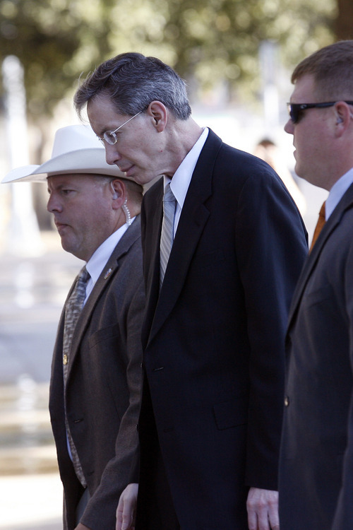 Warren Jeffs, center, on trial for two counts of sexual assault of a child, walks into the Tom Green County Courthouse, Monday, Aug. 1, 2011 flanked by security. In a motion filed Monday, Jeffs quoted God as saying state District Judge Barbara Walther should