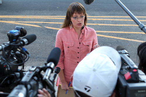 Flora Jessop speaks to the media Monday, Aug. 1, 2011, outside the Tom Green County Courthouse in San Angelo where Fundamentalist Church of Jesus Christ of Latter Day Saints leader Warren Jeffs is on trial for sexual assault of a child. Jessop, a former FLDS member, has been outspoken about the polygamy-sanctioning religious group since her escape in the 1980s.(AP Photo/San Angelo Standard-Times, Patrick Dove)