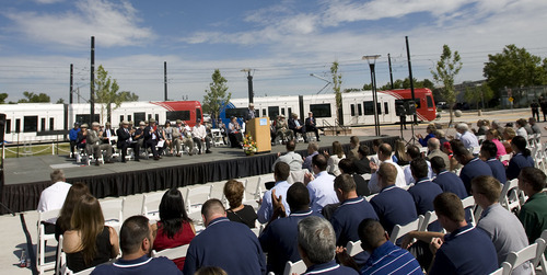 AL HARTMANN  |  The Salt Lake Tribune A crowd of citizens and officials gather at the TRAX West Valley Central Station for a grand opening ceremony Tuesday. The new line, and the Mid-Jordan line, open for business on Sunday.