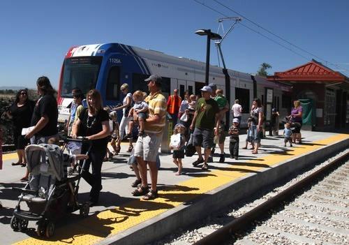 RICK EGAN  |  Tribune File Photo The Utah Transit Authority has scheduled several events leading up to Sunday's official opening of the Mid-Jordan and West Valley TRAX lines. Among the events is a Wednesday free fare day on the new lines -- not the existing ones -- for people who bring a food donation for the poor. This file photo shows an earlier preview of the new Mid-Jordan line for parents and children at the Gardner Village station.