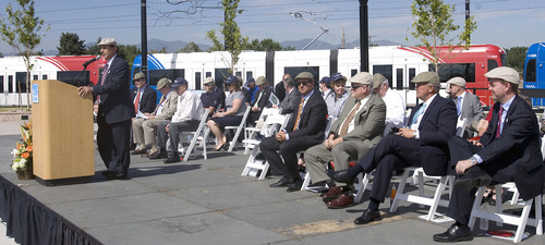 Al Hartmann  |  The Salt Lake Tribune Michael Allegra, General Manager of Utah Transit Authority, left, speaks at opening ceremony at the West Valley Central TRAX Station Tuesday.  Seated down the row are: Greg Hughes, chairman of the UTA Board, William Millar, president, American Public Transportation Asociation, Lane Beattie, president of Salt Lake Chammber of Commerce, and Mike Winder, mayor of West Valley City.
