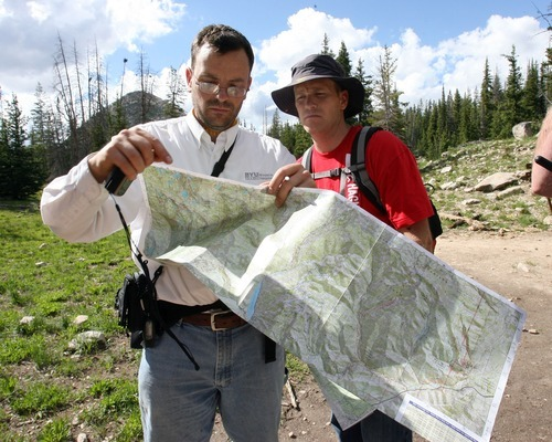 Steve Griffin  |  The Salt Lake Tribune  Aaron Schellenberg, left,  looks at a map with his brother Matthew Schellenberg as they search for Aaron's son Joseph Schellenberg who went missing from his camp site on Long Lake two miles above the Crystal Lake Trailhead in the Unita Mountains above Kamas, Utah Tuesday, August 2, 2011.