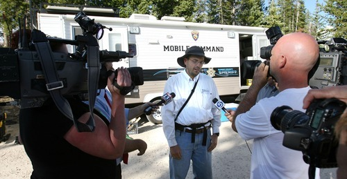 Steve Griffin  |  The Salt Lake Tribune  An exhausted Aaron Schellenberg talks with the media outside the Summit County Sheriff's mobile command center after hiking down the Crystal Lake trail after Summit County search and rescue members found his son, Joseph, who went missing from their camp site on Long Lake two miles above the Crystal Lake trail head in the Unita Mountains above Kamas, Utah Tuesday, August 2, 2011. The Schellenberg family searched all day for their son and were notified by radio that the boy was found  several miles away from his camp.