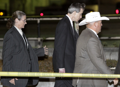 Polygamist religious leader Warren Jeffs, center, is escorted out of the Tom Green County Courthouse Tuesday, Aug. 2, 2011, in San Angelo, Texas. A West Texas jury has heard audio recordings and diary accounts of Jeffs teaching his 14-year-old