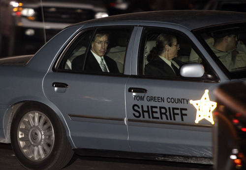 Polygamist leader Warren Jeffs, left, is driven away from the Tom Green County Courthouse by Sheriff's personnel Tuesday, Aug. 2, 2011, in San Angelo, Texas. A West Texas jury has heard audio recordings and diary accounts of  Jeffs teaching his 14-year-old